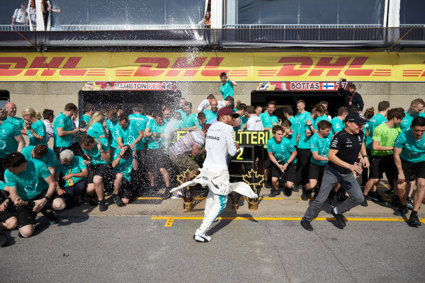 Circuit Gilles Villeneuve, Montreal, Canada. Sunday 11 June 2017. Lewis Hamilton, Mercedes AMG, 1st Position, Valtteri Bottas, Mercedes AMG, 2nd Position, and the Mercedes team celebrate victory. World Copyright: Steve Etherington/LAT Images ref: Digital Imagee SNE18675