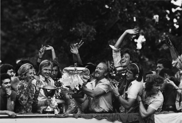 Monza, Italy. 7 - 9 September 1973.Ronnie Peterson (Lotus 72D-Ford) celebrates 1st position on the podium with team boss Colin Chapman, portrait. World Copyright: LAT Photographic.Ref:  L73 - 1578 - 5A.