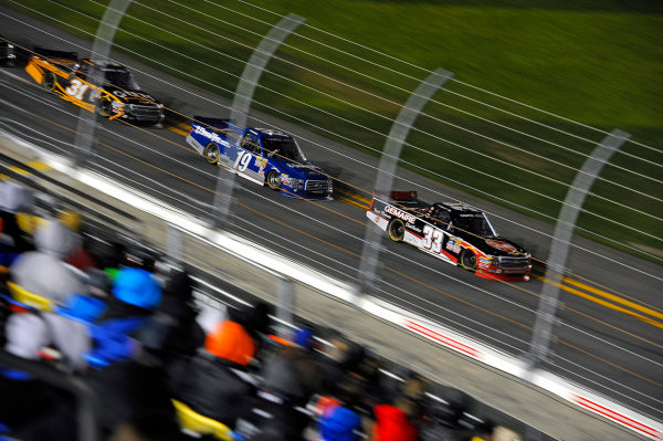 19-20 February, 2015, Daytona Beach, Florida USA Ty Dillon (#33), eventual winner Tyler Reddick and James Buescher race past the main grandstand. ?2015, F. Peirce Williams LAT Photo USA