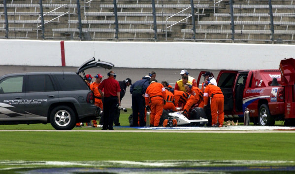 2003 IRL IndyCar Texas,6/5-6/7/03, Saftey crews work to remove Airton Dare after his accidentTexas Motor SpeedwayWorld Copyright-Walt Kuhn 2003 LAT Photographicref: Digital Image Only