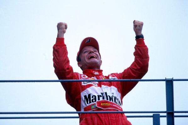 2004 Italian Grand PrixMonza Italy 10th - 12th September.Rubens Barrichello, Ferrari F2004 celebrates his win on the podium.World Copyright: LAT PhotographicRef: 35mm Image: A03