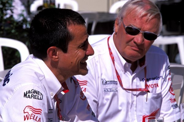 Toyota sporting director Ove Andersson (SWE), right, and team manager Ange Pasquali (FRA), left.United States Grand Prix, Rd15, Indianapolis Motor Speedway, Indianapolis, USA. 28 September 2003.BEST IMAGE