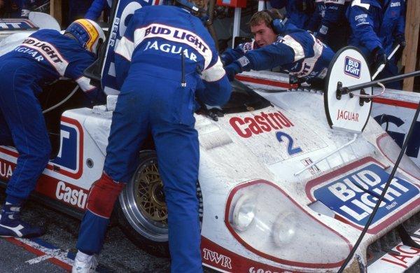 Davy Jones (USA) helps his team mate get into the TWR Jaguar XJR-12D during a pit stop.IMSA GTP Championship, Rd1, Daytona 24 Hours, Daytona Beach, Florida, USA. 2 January 1992.BEST IMAGE