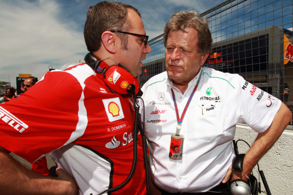 Stefano Domenicali (ITA) Ferrari General Director and Norbert Haug (GER) Mercedes Sporting Director on the grid. Formula One World Championship, Rd7, Canadian Grand Prix, Race, Montreal, Canada, Sunday 10 June 2012.