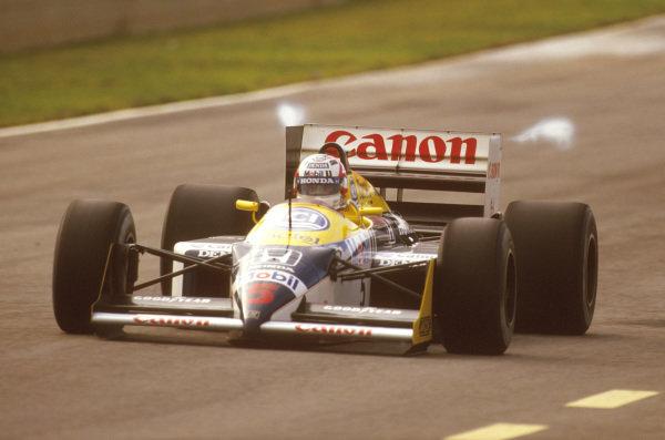 Jerez, Spain.25-27 September 1987.Nigel Mansell (Williams FW11B Honda) 1st position.Ref-87 ESP 10.World Copyright - LAT Photographic