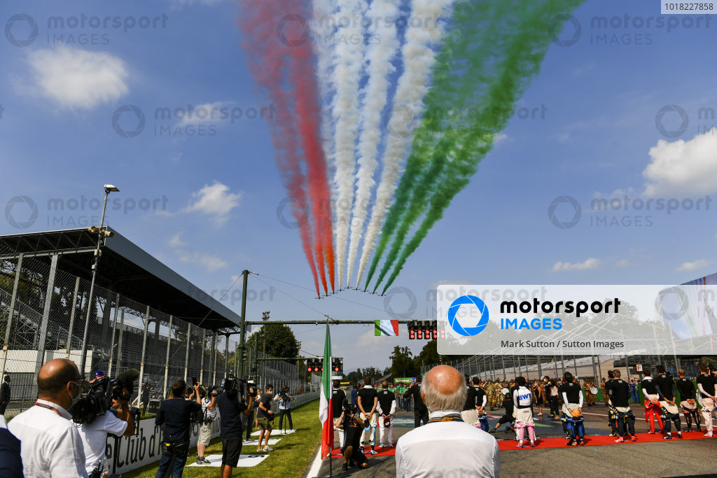 Frecce Tricolori fly over the grid prior to the start in their Aermacchi MB339A jet trainers