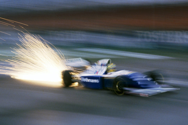 The Williams FW16 of Ayrton Senna (BRA) sends out a shower of sparks whilst testing before the opening race of the season. Formula One Testing, Silverstone, England, 24 February 1994. Catalogue Ref: 10-047