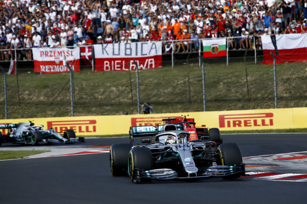 Lewis Hamilton, Mercedes AMG F1 W10 leads Charles Leclerc, Ferrari SF90 and Valtteri Bottas, Mercedes AMG W10