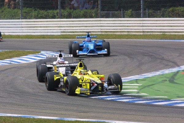 2001 German Grand Prix - RaceHockenheim, Germany. 29th July 2001Ricardo Zonta, Jordan Honda EJ11 leads Olivier Panis, BAR Honda BAR003, and Jenson Button, Benetton Renault B201, action.World Copyright - LAT PhotographicRef: 9 MB Digital File Only