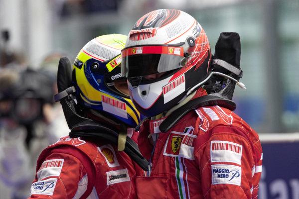 Teammates Kimi Räikkönen and Felipe Massa congratulate each other in parc fermé.