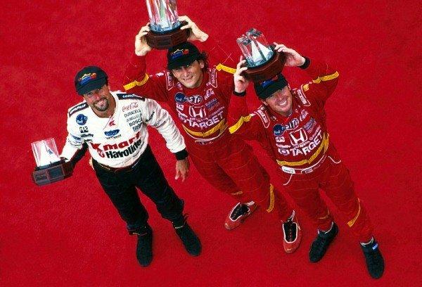 Alex Zanardi (ITA) celebrates victory on the podium. The other podium finishers are Michael Andretti (USA) left, and Jimmy Vasser (USA) right. CART Fedex World Series, Toronto, Canada. 19 July 1998.