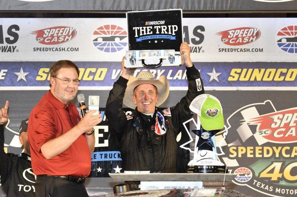 #51: Greg Biffle, Kyle Busch Motorsports, Toyota Tundra Toyota, celebrates in victory lane.
