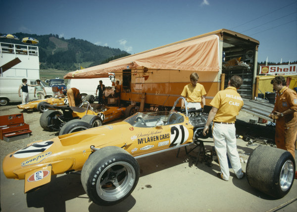 Alistair Caldwell in the McLaren paddock area with Denny Hulme's McLaren M14A Ford.