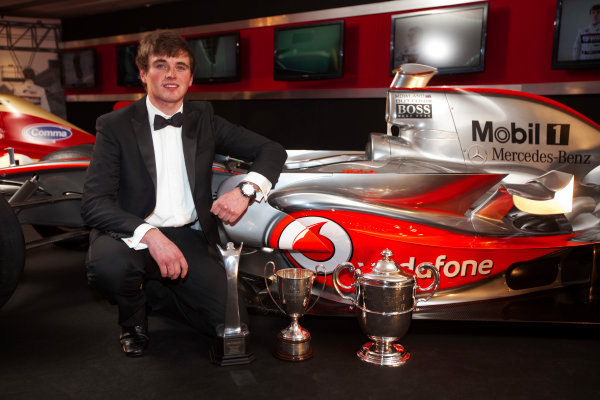 Grosvenor House Hotel, Park Lane, London 4th December 2011 McLaren Autosport BRDC Young Driver of the Year Award winner Oliver Rowland poses with the McLaren Mercedes F1 display car.World Copyright: Glenn Dunbar/LAT Photographic ref: Digtal Image GD5D0418