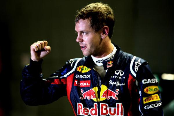 Marina Bay Circuit, Singapore.24th September 2011.Sebastian Vettel, Red Bull Racing RB7 Renault, celebrates pole. Portrait. World Copyright: Andy Hone/LAT Photographicref: Digital Image CSP28571