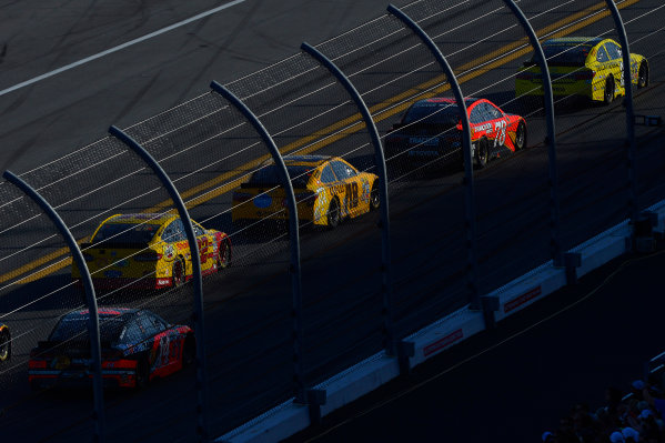 13-21 February, 2016, Daytona Beach, Florida USA Matt Kenseth, Dollar General Toyota Camry, Martin Truex Jr, Furniture Row Toyota Camry, Kyle Busch, M&M's 75 Toyota Camry and Joey Logano speed to turn one as the west side of the track falls into shadow in the closing laps. ?2016, F. Peirce Williams LAT Photo USA