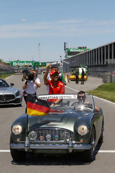 Sebastian Vettel (GER) Ferrari on the drivers parade .