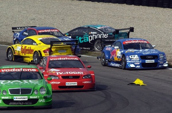 Problems at the first corner during the main race when Martin Tomczyk (GER) Team Abt-Sportsline Junior Audi TT and Michael Bartels (GER) Team Holzer Opel Astra spin off.