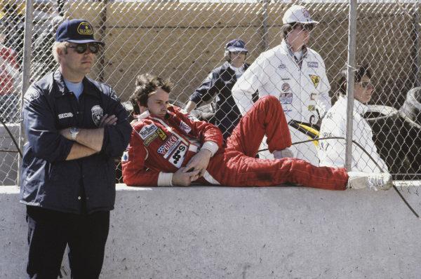 Long Beach, California, USA. 6 - 8 April 1979.Gilles Villeneuve (Ferrari 312T4) 1st position, relaxes in the pits, portrait.World Copyright: LAT Photographic.Ref: 79LB26