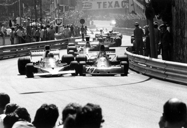 1974 Monaco Grand Prix.Monte Carlo, Monaco.23-26 May 1974.Denny Hulme, McLaren M23, locks wheels with Jean-Piere Beltoise, BRM P20, as they race through Beau Rivage which leaded to a multi-car crash. The race was stopped and 7 cars were retired, action.Ref-6412/14.World Copyright: LAT Photographic