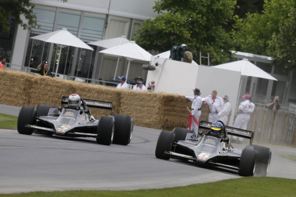 2014 Goodwood Festival of Speed. Goodwood Estate, West Sussex, England. 26th - 29th June 2014. A pair of Lotus 79 with the drivers wearing Mario Andretti and Ronnie Peterson helmets. World Copyright: Gary Hawkins/LAT Photographic.