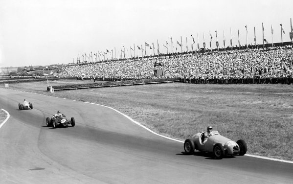 "1955 British Grand Prix Aintree, Great Britain. 16 July 1955.""Mike Sparken"" (Gordini 16) leads Horace Gould (Maserati 250F) and Hermanos da Silva Ramos (Gordini 16) passed the horse racing fences Ref: Published ""Autocar"" 22/7/1955World Copyright: LAT Photographic"