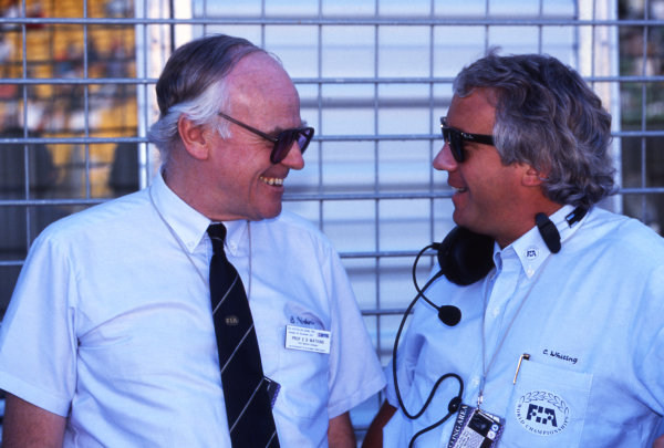 (L to R): Sid Watkins (GBR) FIA Doctor talks with Charlie Whiting (GBR) FIA Delegate. Formula One World Championship, Rd16, Australian Grand Prix, Adelaide, Australia, 4 November 1990.