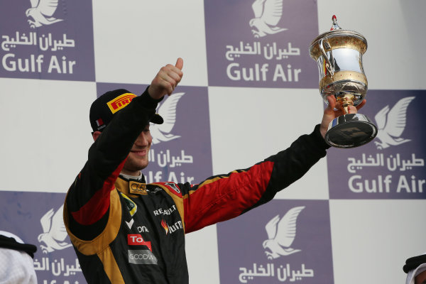 Bahrain International Circuit, Sakhir, Bahrain Sunday 21st April 2013 Romain Grosjean, Lotus F1, 3rd position, with his trophy. World Copyright: Andy Hone/LAT Photographic ref: Digital Image HONZ3072