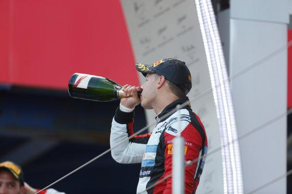 2013 GP3 Series. Round 4.  Nurburgring, Germany.  6th July 2013.  Saturday Race. Facu Regalia (ARG, ART Grand Prix) celebrates his victory on the podium.  World Copyright: Andrew Ferraro/GP2 Series Media Service. Ref: _79P5816