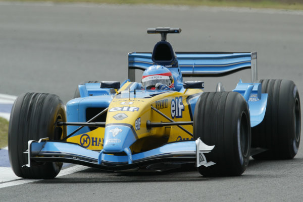 2003 British Grand Prix - Fridayl Qualifying,Silverstone, Britain. 18th July 2003 Fernando Alonso, Renault R23, action.World Copyright LAT Photographic.Digital Image Only.