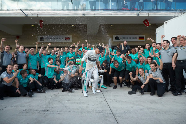 Circuit of the Americas, Austin, Texas, United States of America. Sunday 2 November 2014. Lewis Hamilton, Mercedes AMG celebrates with the team and Nico Rosberg, Mercedes AMG after winning the race. World Copyright: Steve Etherington/LAT Photographic. ref: Digital Image SNE25059