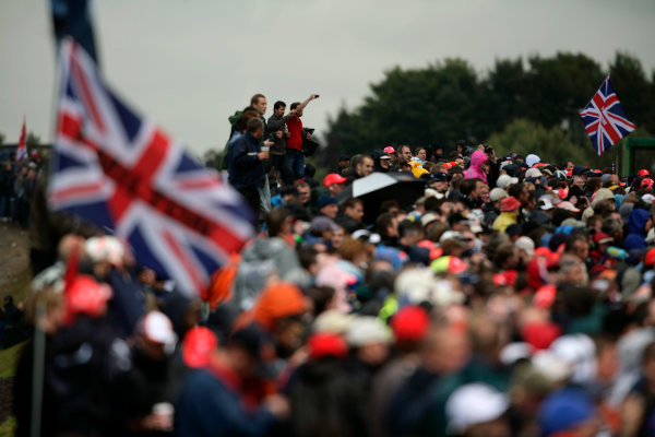 Silverstone, Northamptonshire, UK. 6th July 2008. Fans of Lewis Hamilton, McLaren MP4-23 Mercedes wave flags in the crowd. Atmosphere. World Copyright: Drew Gibson/LAT Photographic. ref: Digital Image _Y2Z5208