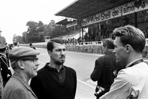 Jo Bonnier (SWE) (Facing, centre) talks with his Porsche team mate Dan Gurney (USA) (right) who would take his and PorscheÕs first Grand Prix victory.  With them (left) is Porsche team manager Huschke von Hanstein. French Grand Prix, Rouen-les-Essarts, 8 July 1962.