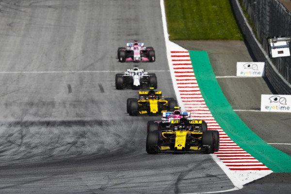 Nico Hulkenberg, Renault Sport F1 Team R.S. 18, leads Esteban Ocon, Force India VJM11 Mercedes, Carlos Sainz Jr., Renault Sport F1 Team R.S. 18, and Lance Stroll, Williams FW41 Mercedes.