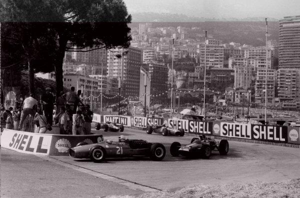 1966 Monaco Grand Prix.Monte Carlo, Monaco. 22 May 1966.Guy Ligier, Cooper T81-Maserati, not classified, leads Bob Bondurant, BRM P261, 4th position, Jo Bonnier, Cooper T81-Maserati, not classified, and Jim Clark, Lotus 33-Climax, retired, action.World Copyright: LAT PhotographicRef: Motor b&w print