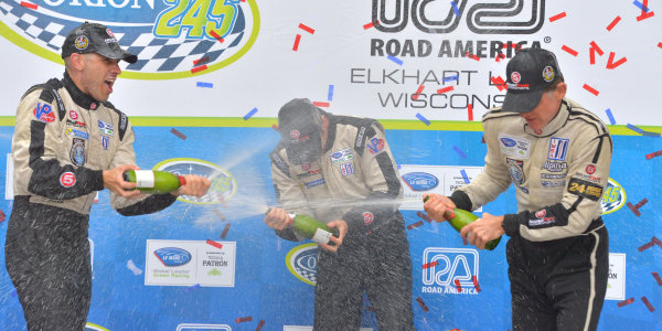 9-11 August, 2013, Elkhart Lake, Wisconsin USA #551 Level 5 Motorsports HPD with champagne shower on podium for Marino Franchitti, Simon Pagenaud and Scott Tucker ©Dan R. Boyd LAT Photo USA