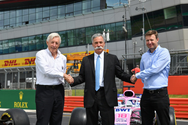 John Grant, Chairman of the BRDC, Chase Carey, Chairman, Formula 1 and Stuart Pringle, Managing Director of Silverstone Circuits