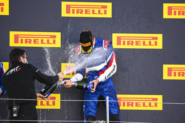 Race winner Alexander Smolvar (RUS, ART GRAND PRIX) celebrates on the podium with the chmapagne