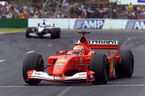 Australian Grand Prix.Albert Park, Melbourne, Australia. 2-4 March 2001.Race winner Michael Schumacher (Ferrari F2001) leads Mika Hakkinen (McLaren MP4/16 Mercedes).World Copyright - Steve Etherington/LAT Photographicref: 18MB Digital Image