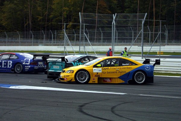 2002 DTM Championship.Hockenheim, Germany. 5-6 October 2002.Michael Bartels (Holzer/Opel Astra V8 Coupe DTM) and Manuel Reuter (Phoenix/Opel Astra V8 Coupe DTM) also collide, as a result of the mess at the Spitzkehre. World Copyright - Andre Irlmeier/LAT PhotographicSpitzkehre sequence - 7.