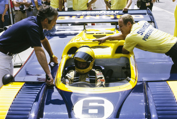 Roger Penske in conversation with Mark Donohue, Penske Racing, Porsche 917/30 TC, and an engineer.