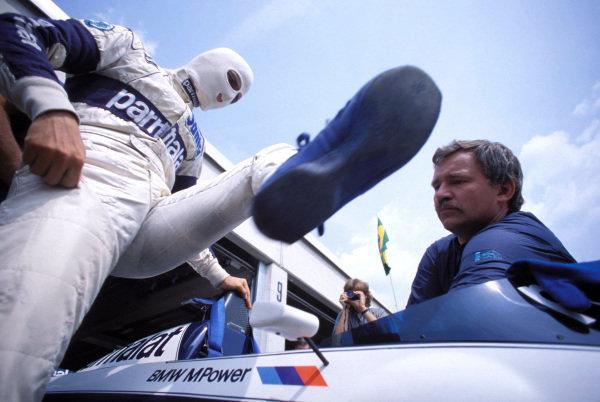 Nelson Piquet climbs into his Brabham BT52B BMW.