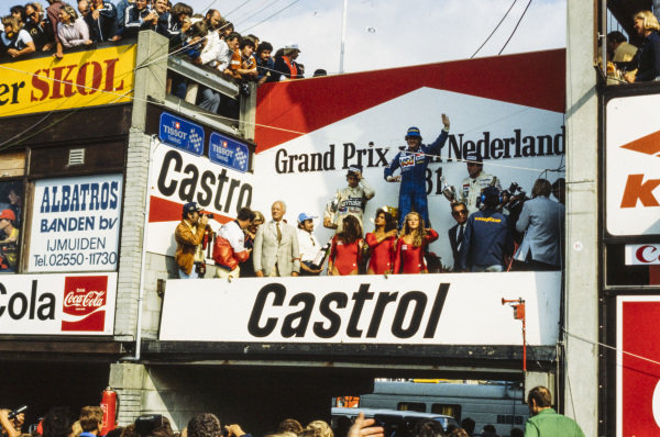 Alain Prost, 1st position, Nelson Piquet, 2nd position and Alan Jones, 3rd position, on the podium.