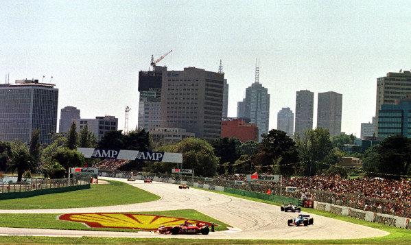 1998 Australian Grand Prix.Albert Park, Melbourne, Australia.6-8 March 1998.Jacques Villeneuve (Williams FW20 Mecachrome) leads Giancarlo Fisichella (Benetton B198 Playlife) and Johnny Herbert (Sauber C16 Petronas Ferrari).World Copyright - LAT Photographic