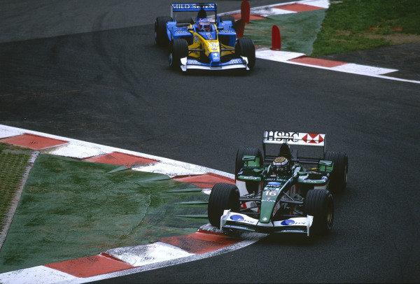 2002 Belgian Grand Prix.Spa-Francorchamps, Belgium. 30/8-1/9 2002.Eddie Irvine (Jaguar R3) followed by Jenson Button (Renault R202) through the Bus Stop Chicane. Irvine came home in 6th position.Ref-02 BEL 20.World Copyright - Bellanca/LAT Photographic