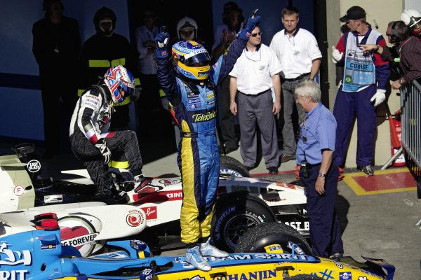 Fernando Alonso celebrates winning his second world championship.
