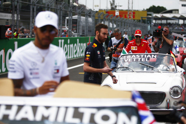 Sebastian Vettel, Ferrari, and Lewis Hamilton, Mercedes AMG F1, during the drivers parade