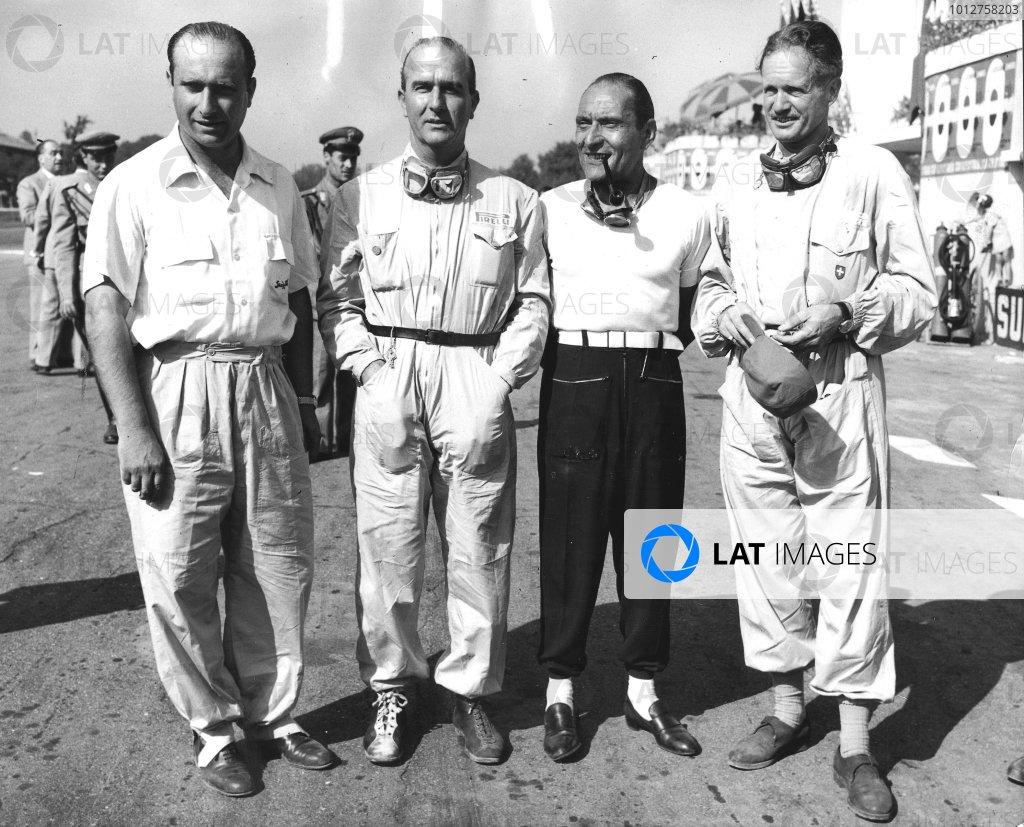 1950 Italian Grand Prix. Monza, Italy. 1-3 September 1950. The Alfa Romeo team before the start. (L-R) Juan Manuel Fangio, Giuseppe Farina, Felice Bonetto and Emmanuel de Graffenried. World Copyright - LAT Photographic