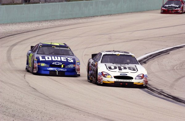 2002 NASCAR Miami, USA November 14-17,2002,Homestead-Miami Motorsports Complex-Jimmie Johnson and Dale Jarrett racing into turn one,-Robt LeSieur2002LAT Photographic