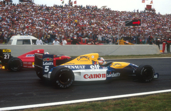 1991 French Grand Prix.Magny-Cours, France.5-7 July 1991.Nigel Mansell (Williams FW14 Renault) passes Alain Prost (Ferrari 643). They finished in 1st and 2nd positions respectively.Ref-91 FRA 01.World Copyright - LAT Photographic
